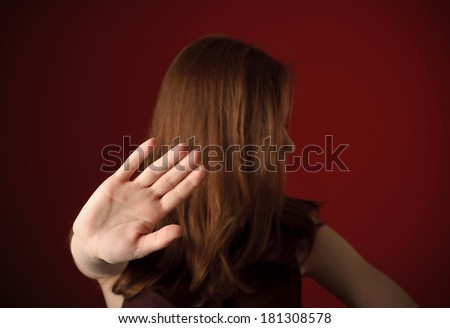 Woman with hand signaling to stop - stock photo