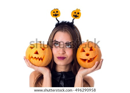 Woman with handband holding two pumpkins
