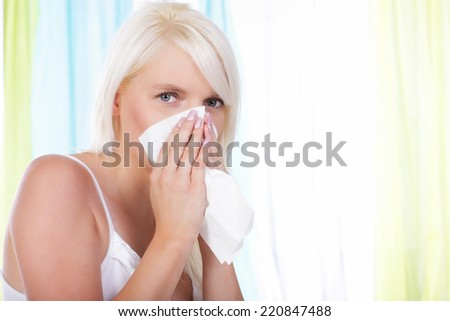 Woman with handkerchief and cold