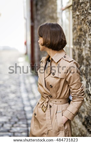 Woman with hands in pocket look behind