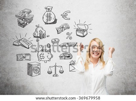 woman with hands raised in the gesture of winning, eyes closed, black pictures symbolizing money near her. Concrete background. Front view. Concept of running into money. - stock photo