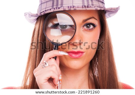 Woman with hat looking through magnifier glass, isolated on white - stock photo