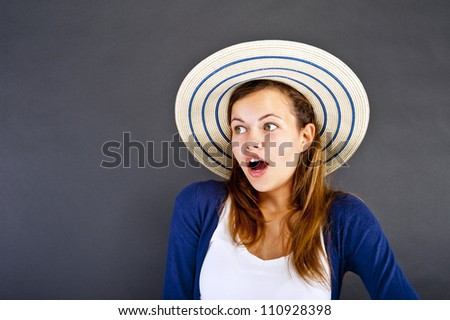 Woman with hat on her head scary face