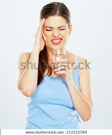 woman with headache hold water glass . white background isolated . - stock photo