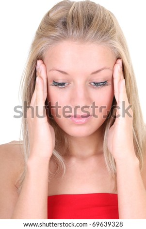 woman with headache holding her head with hands over white
