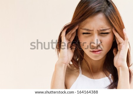 woman with headache, migraine, stress, insomnia, hangover in casual dress with blank space - stock photo