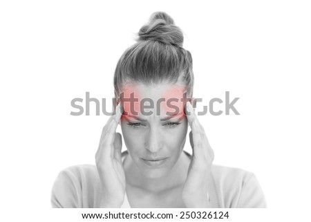 Woman with headache touching her temples on white background - stock photo
