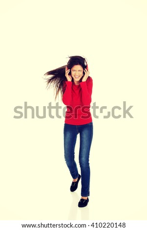 Woman with headphones listening music. - stock photo
