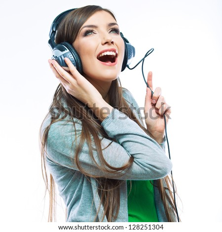 Woman with headphones listening music . Music teenager girl dancing against isolated white background. Teen life style concept. - stock photo