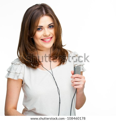 Woman with headphones listening  music on mp3 player. Music teenager girl isolated on white background - stock photo