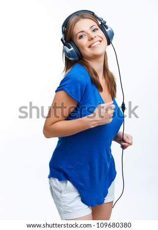 Woman with headphones listening music on player. Music teenager girl against isolated white background - stock photo