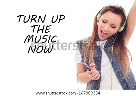 Woman with headphones listening music. Teenager girl dancing. Easy to remove inscription: Turn up the music. Isolated on white - stock photo