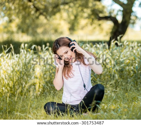 Woman with Headphones Outdoors