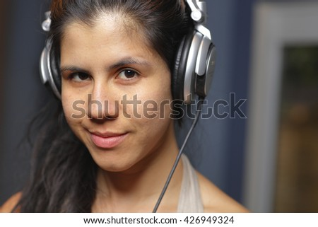 Woman with headphones smiling at camera hiphop  - stock photo