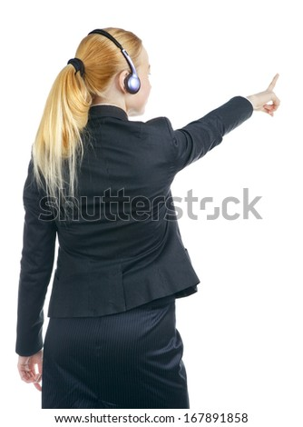 woman with headset pointing at something, rear view - stock photo