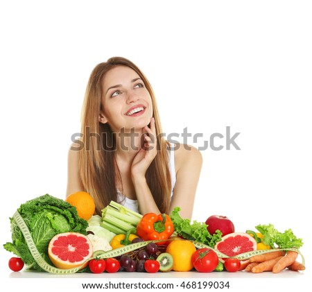 Woman with healthy food on white background