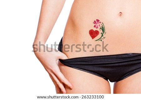 Woman with heart shaped glitter-tattoo, isolated on white - stock photo