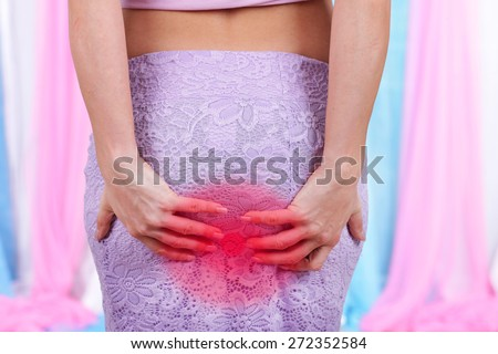 Woman with hemorrhoids and constipation