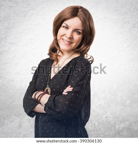 Woman with her arms crossed - stock photo