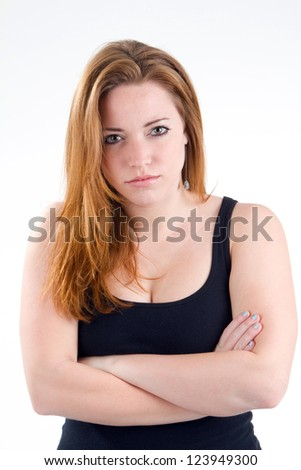 Woman with her arms crossed and a stern unpleasant serious attitude look on her face.