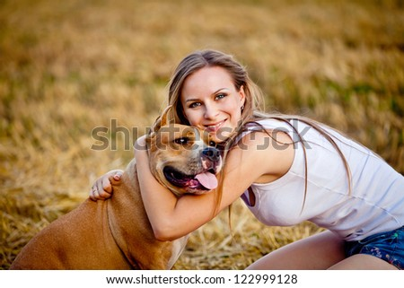woman with her beautiful dog - stock photo