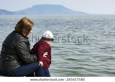 Woman with her daughter at Lake Balaton, Hungary - stock photo