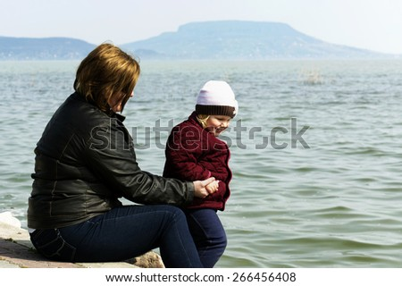 Woman with her daughter at Lake Balaton, Hungary - stock photo