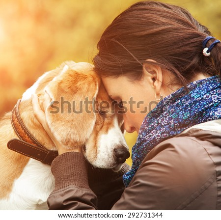 Woman with her dog tender scene - stock photo