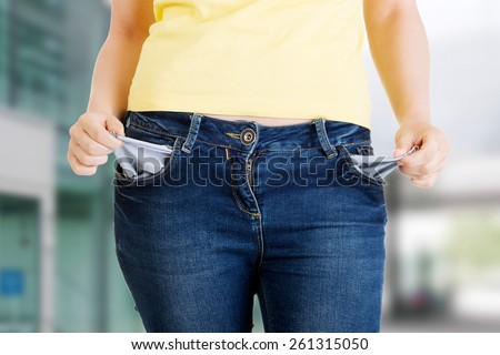 Woman with her empty pockets - stock photo