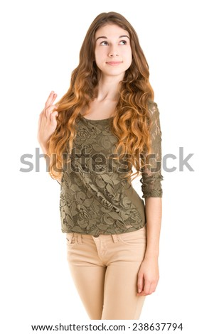 Woman with her fingers crossed for good luck, isolated in white - stock photo