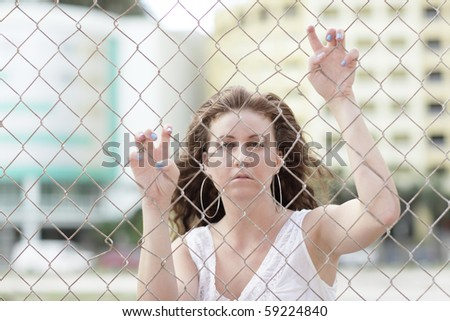 Woman with her hands on the fence