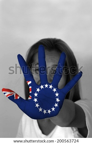 woman with her hands signaling to stop and Cook Island flag
