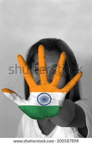 woman with her hands signaling to stop and India flag - stock photo