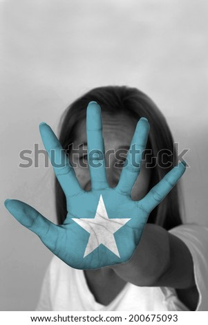 woman with her hands signaling to stop and Somalia flag