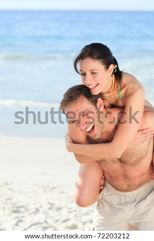 Woman with her husband on the beach