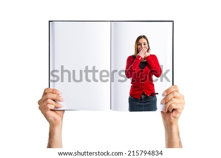 Woman with her mouth closed by her hands printed on book - stock photo