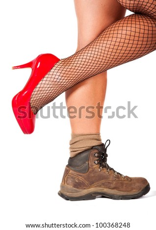 Woman with high hills and walking shoe shot against a white background - stock photo