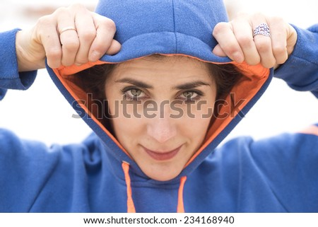Woman with hood closeup portrait. - stock photo
