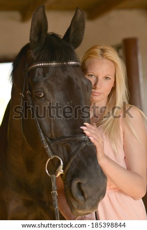 woman with horse - stock photo