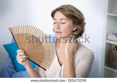 Woman With Hot Flush - stock photo