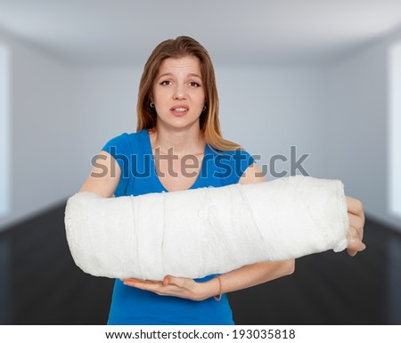 Woman With Huge Broken Hand In Bandage - stock photo