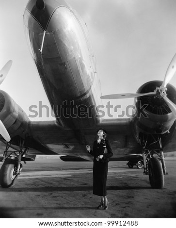 Woman with huge plane - stock photo