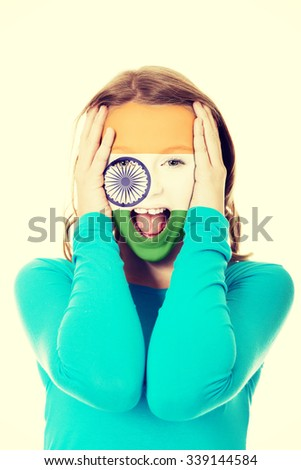 Woman with Indie flag painted on face. - stock photo