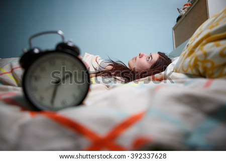 Woman with insomnia touching her head - stock photo