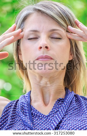 woman with intense stress and painful headache - stock photo