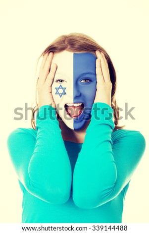 Woman with Israel flag painted on face. - stock photo