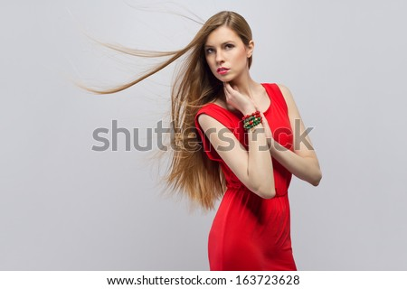 Woman with jewelery wearing red dress  - stock photo