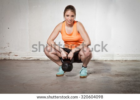 woman with kettlebell - stock photo