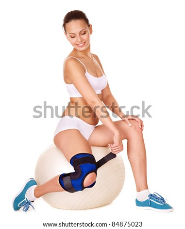 Woman with knee brace. Isolated. - stock photo