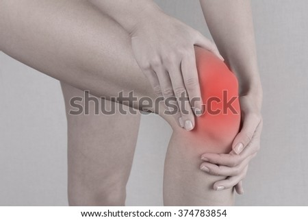 Woman with knee pain close up. Pain relief concept - stock photo